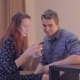 Young Couple Looks At The Phone At Home - VideoHive Item for Sale