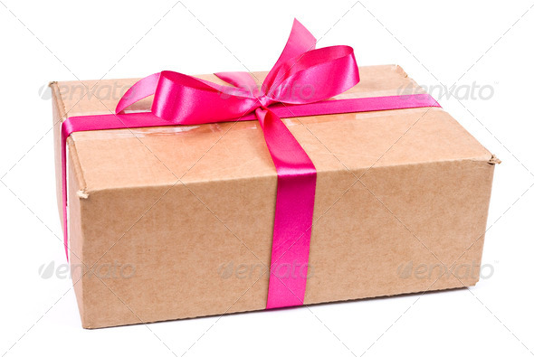 Cardboard box with red bow - Stock Photo - Images