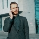 Businessman Talking On The Phone On Skyscraper Background - VideoHive Item for Sale
