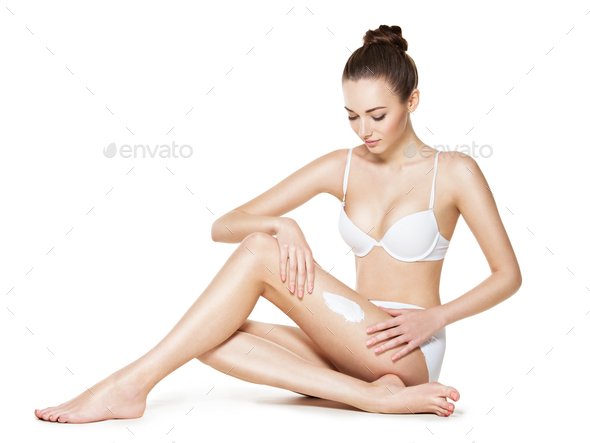 beautiful young woman depilating legs by waxing - Stock Photo - Images