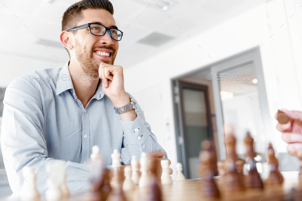 Young man playing chess - Stock Photo - Images