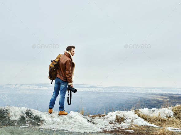 Man with camera - Stock Photo - Images