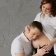 A Handsome Young Man Nuzzles The Belly Of His Pregnant Wife. Young Wife Pats Him On The Head And - VideoHive Item for Sale