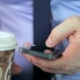 Man's Hands Using Mobile Phone Touchscreen And Coffee - VideoHive Item for Sale