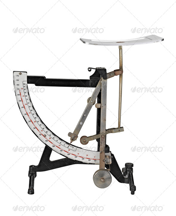 Antique rust letter weight scale - Stock Photo - Images