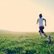 Runner athlete running on grass seaside - PhotoDune Item for Sale