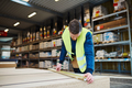 Young handyman working in a warehouse - PhotoDune Item for Sale