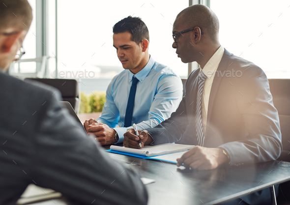 Business executives in a management meeting - Stock Photo - Images