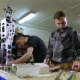 Two Men Repair The Robot In The Workshop - VideoHive Item for Sale
