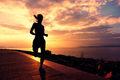 Sporty fitness woman running on sunrise seaside trail - PhotoDune Item for Sale