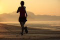 Sporty fitness woman running on sunrise beach - PhotoDune Item for Sale