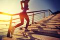 Healthy lifestyle woman running upstairs on sunrise seaside - PhotoDune Item for Sale