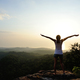 Successful woman with open arms on sunset mountain top - PhotoDune Item for Sale