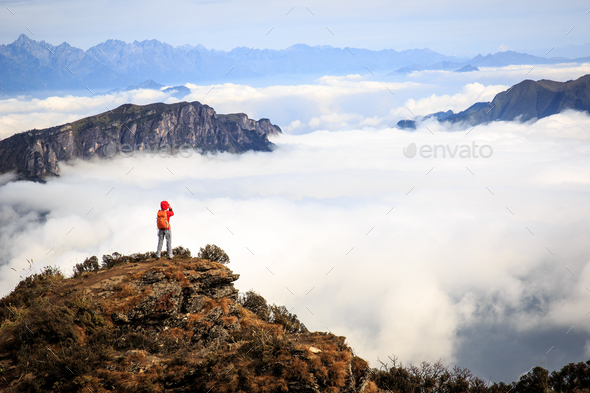 young woman photographer taking photo for beautiful landscape on - Stock Photo - Images