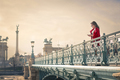 Woman texting on a bridge - PhotoDune Item for Sale