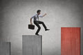 Businessman jumping on a graph - PhotoDune Item for Sale