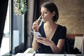 Woman texting and drinking - PhotoDune Item for Sale