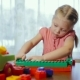 Portrait Of a Little Girl Playing With Toy Blocks - VideoHive Item for Sale