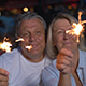 Happy Senior Man And Woman With Sparklers - VideoHive Item for Sale