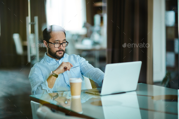Serious businessman at work - Stock Photo - Images
