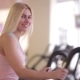 Girl Smiling To Camera During Workout On Orbitrek - VideoHive Item for Sale