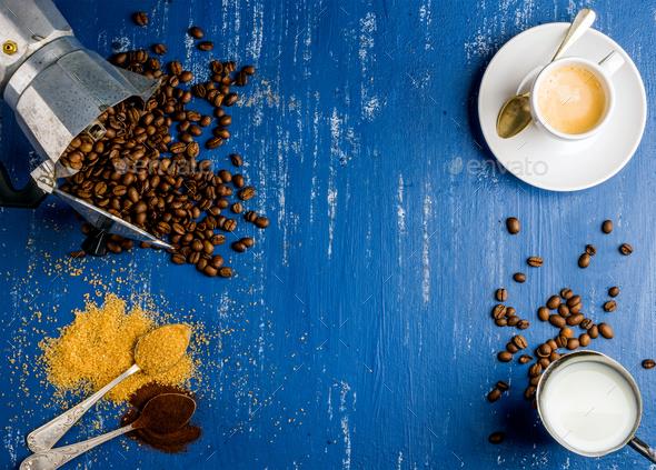 Espresso cup, cream, arabika beans in moka pot
