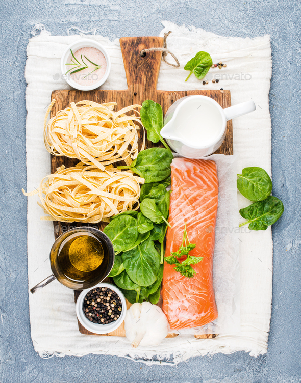 Ingredients for cooking pasta tagliatelle with salmon, spinach and cream - Stock Photo - Images
