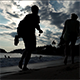 Backpackers Walking Over the Beach at Sunset - VideoHive Item for Sale