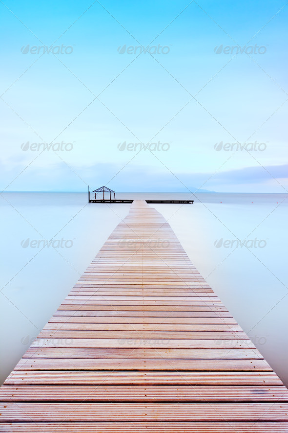 Wooden pier in a cold atmosphere. Tuscan coast. - Stock Photo - Images