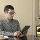 A Young Man Looks Through His Tablet As He Hakes - VideoHive Item for Sale