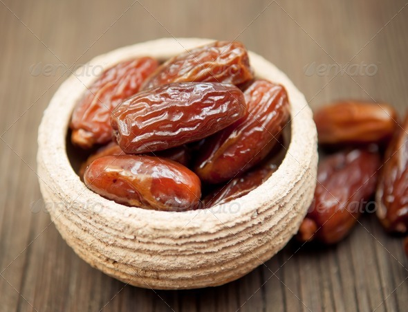 Dates in small bowl - Stock Photo - Images