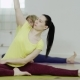 Young Woman Is Practicing The Head-to-Knee Pose - VideoHive Item for Sale
