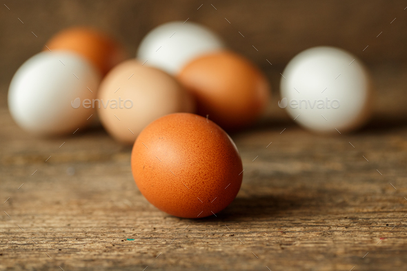 Fresh chicken eggs on a wooden  background - Stock Photo - Images