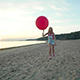 Girl Lets Go A Balloon On The Beach - VideoHive Item for Sale