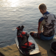 Wakeboarder Resting After A Workout On The Pier. - VideoHive Item for Sale
