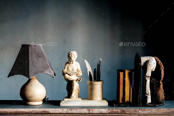 Lamp and a bookshelf at home interior. - Stock Photo - Images