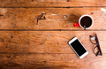 Smartphone, cup of coffee and eyeglasses on office desk - PhotoDune Item for Sale