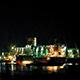 Tanker Docking Near City On Rainy Night