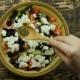Female Hand Sprinkle Seasoning to Greek Salad - VideoHive Item for Sale