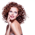 Beautiful smiling thoughtful woman with curly hair. - PhotoDune Item for Sale