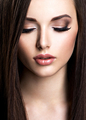 Face of beautiful young woman with brown make-up and  straight - PhotoDune Item for Sale