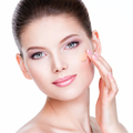 Beautiful face of young woman with cosmetic foundation on a skin - PhotoDune Item for Sale