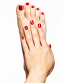 Closeup photo of a female feet with beautiful red pedicure - PhotoDune Item for Sale