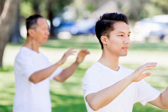 People practicing thai chi in park - Stock Photo - Images