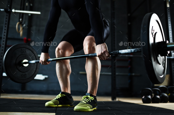 Lifting barbell in gym - Stock Photo - Images