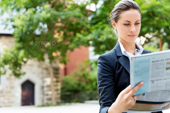 Portrait of business woman smiling outdoor - Stock Photo - Images
