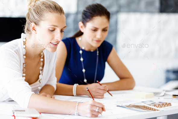 Two female colleagues in office - Stock Photo - Images