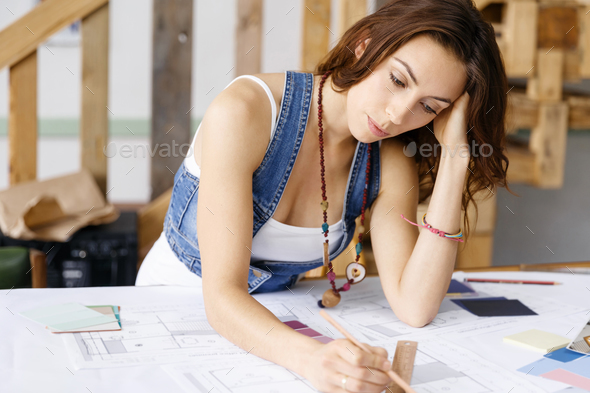 Young pretty woman at her desk - Stock Photo - Images