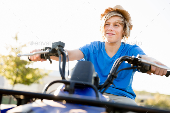 Boy riding farm truck in vineyard - Stock Photo - Images