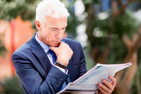 Portrait of confident businessman outdoors - Stock Photo - Images